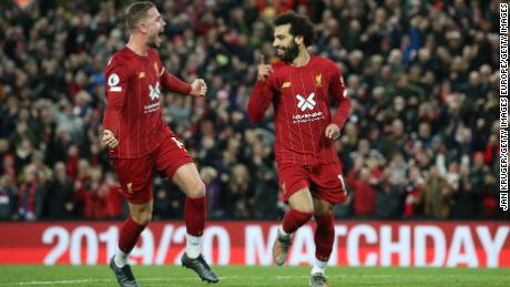 Mohamed Salah's second-half penalty helped Liverpool defeat Tottenham 2-1 at Anfield.