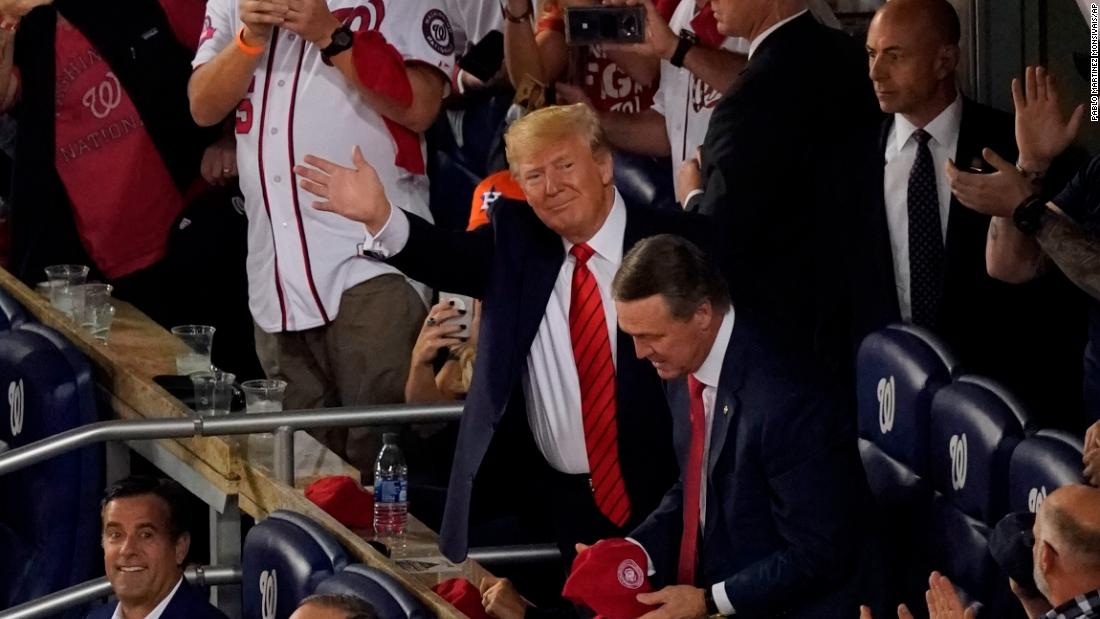 Trump gets cheers, boos and 'lock him up' chants at World Series in DC