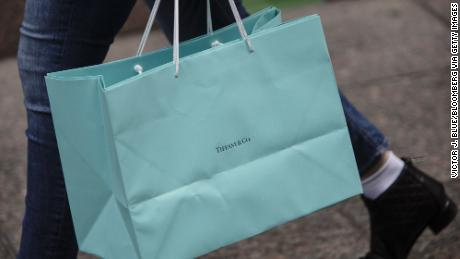 A shopper carrying a Tiffany store bag on Fifth Avenue in New York.