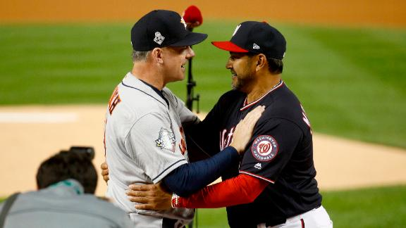 Houston manager A.J. Hinch, left, and Washington manager Dave Martinez embrace each other prior to Game 3.