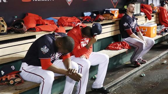 Washington players react in the dugout during the ninth inning of Game 5. The Nationals lost 7-1 to fall behind three games to two. They lost all three of their home games, scoring only one run in each.