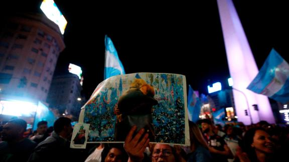 Supporters of Argentina's presidential candidate for the Frente de Todos party Alberto Fernandez celebrate his win in the general elections at Obelisco in Buenos Aires on October 27, 2019.