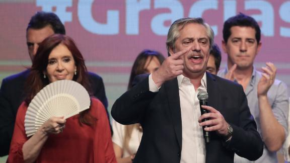 Argentina's president elect Alberto Fernandez (R) delivers a speech next to his vice-president elected Cristina Fernandez (L) at the party's headquarters in Buenos Aires on October 27, 2019.