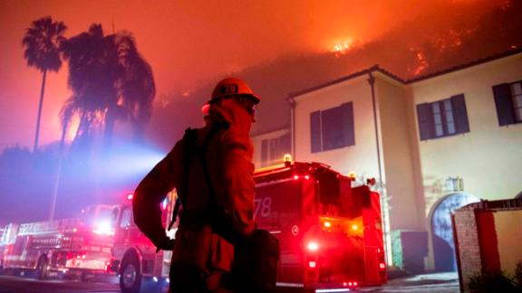 A firefighter watches a flames approach the Mandeville Canyon neighborhood during the Getty fire, Monday, Oct. 28 in Los Angeles.