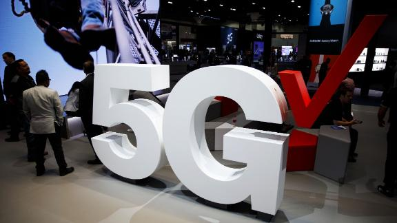 Verizon Communications Inc. 5G wireless signage is displayed at the company's booth during the Mobile World Congress Americas in Los Angeles, California, U.S., on Wednesday, Sept. 12, 2018. The conference features prominent executives representing mobile operators, device manufacturers, technology providers, vendors and content owners from across the world. Photographer: Patrick T. Fallon/Bloomberg via Getty Images