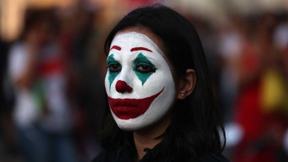 A Lebanese demonstrator with her face painted like the comic book character the Joker takes part in a protest in Beirut on October 19.