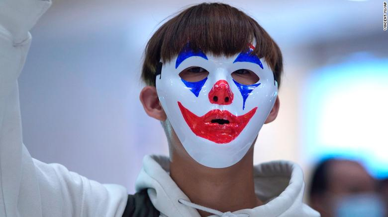 A protester wears a Joker mask during a protest in Hong Kong on October 18, 2019.