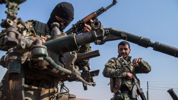 Kurdish forces withdraw from an area near the Turkish border with Syria on Sunday, October 27.