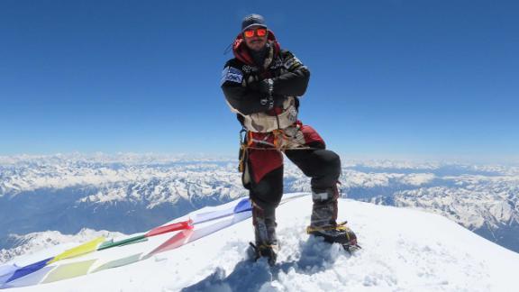 Nims Purja stands atop Nanga Parbat (8,126m).