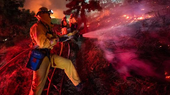 Firefighters work near the Getty Center in Los Angeles on Monday, October 28.