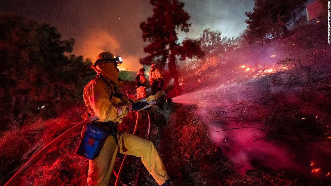 Firefighters work near the Getty Center in Los Angeles on October 28.