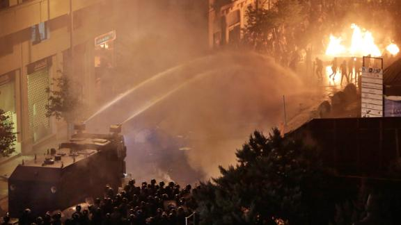 Lebanese police use a water cannon on anti-government protesters on October 18.