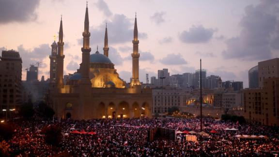 A rally takes place in Beirut outside the Mohammad al-Amin Mosque and the nearby Maronite Cathedral of St. George on Sunday, October 20.