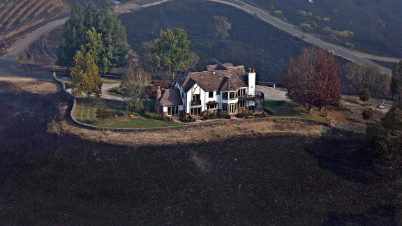A home between Healdsburg and Windsor is surrounded by charred ground on October 29.