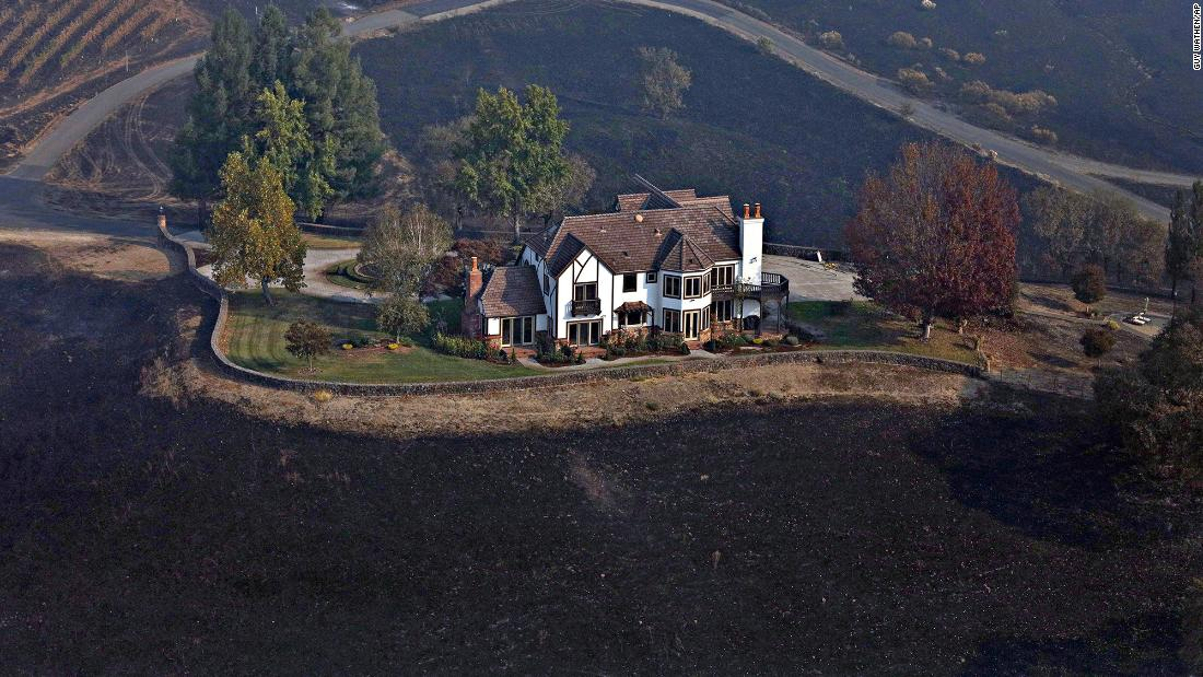 A home between Healdsburg and Windsor, California, stands surrounded by charred ground on October 29.