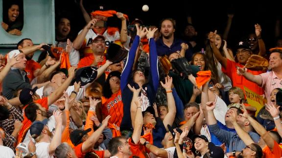 Fans try to catch Bregman's home run in Game 6.
