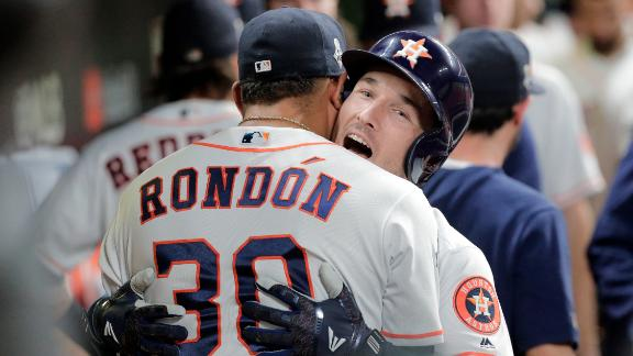 Bregman is congratulated in the dugout after hitting a home run in the first inning of Game 6.