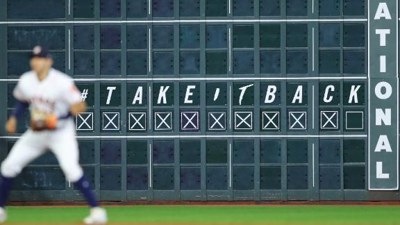 A scoreboard in Houston shows the Astros one win away from the title.