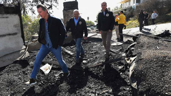 From left, California Gov. Gavin Newsom, Los Angeles City Councilman Mike Bonin and Los Angeles Mayor Eric Garcetti tour a burned home in Brentwood, California, on October 29.