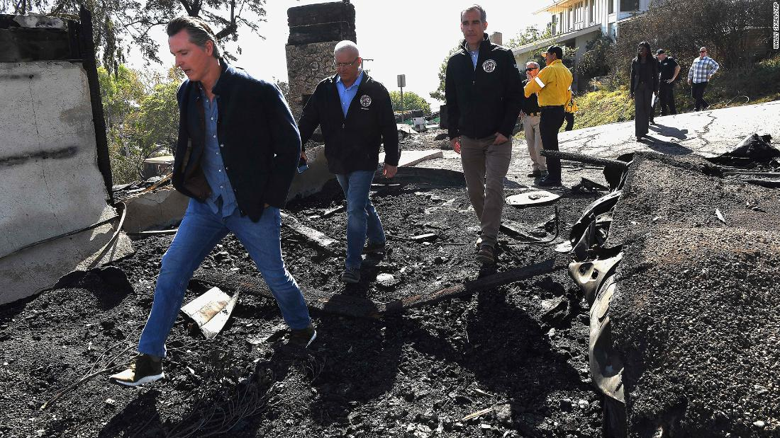 California Governor Gavin Newsom, Los Angeles City Councilman Mike Bonin, and Los Angeles City Mayor Eric Garcetti tour a burned home along Tigertail Road in Brentwood, California, on October 29.