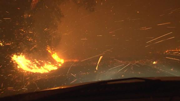 A driver tries to get past the Kincade Fire in Northern California.