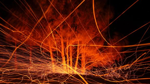 High winds blow hot embers from the Kincade Fire on October 29, 2019 in Calistoga, California.