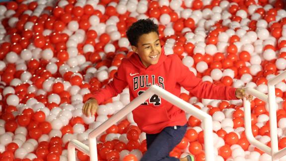 "A child plays in a ball pit at Toys ""R"" Us Adventure Chicago Opening Preview on October 23, 2019 in Chicago"