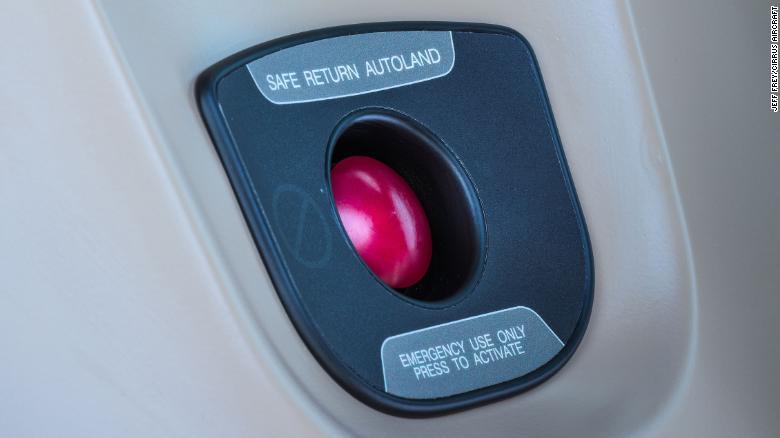 Any occupant could press this red button and the plane would make an emergency landing on its own, Cirrus said.
