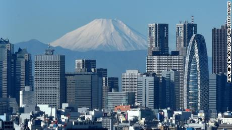 A snow-covered Mount Fuji is seen behind Tokyo in this file photo from 2014.