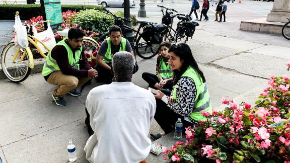 Members of Detroit Street Care attending to a homeless patient on the street.