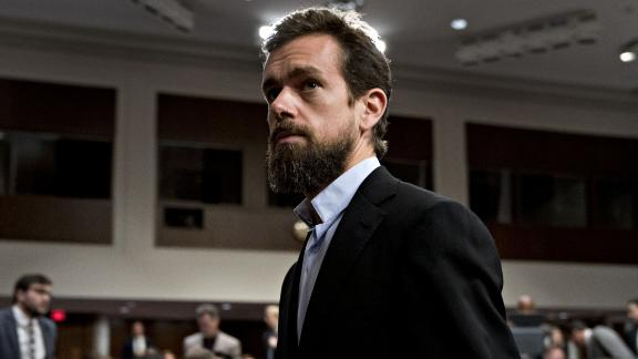 Jack Dorsey, co-founder and chief executive officer of Twitter Inc., leave for a break during the Senate Intelligence Committee hearing in Washington, D.C., U.S., on Wednesday, Sept. 5, 2018. Lawmakers from both sides of the aisle have increased pressure on technology companies on Russian interference in the 2016 presidential campaign and other election meddling as well as issues including alleged anti-conservative bias and antitrust questions. Photographer: Andrew Harrer/Bloomberg via Getty Images