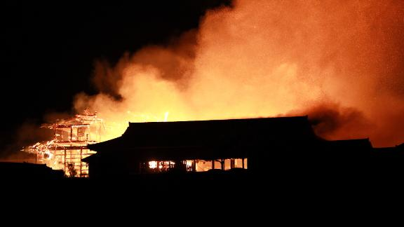 The main building of the Shuri Castle is seen on fire in Naha, Okinawa prefecture, southern Japan, early 31 October 2019.