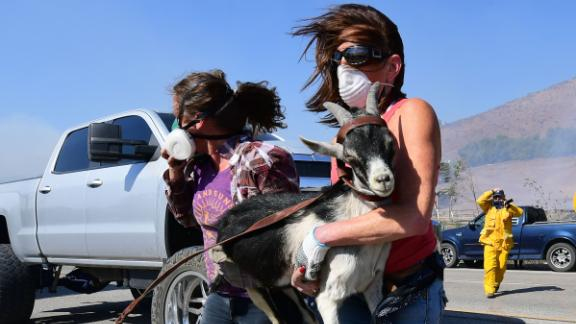Laura Horvitz, right, and Robyn Phipps help rescue goats from a ranch near the Reagan Presidential Library.