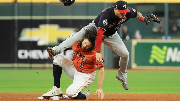 Washington second baseman Asdrubal Cabrera collides with Jake Marisnick as he turns a double play in Game 7.