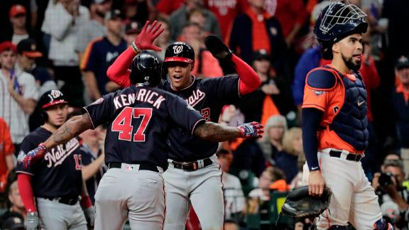 Washington's Howie Kendrick is congratulated by teammate Juan Soto after his home run gave the Nationals a 3-2 lead in the seventh inning.