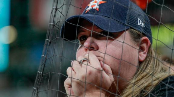 An Astros fan watches as her team trailed in the eighth inning. The home team lost all seven games of the series.