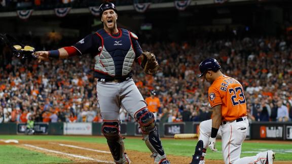 Washington catcher Yan Gomes celebrates after Michael Brantley struck out to end the game.