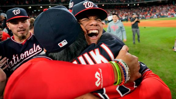 Nationals left fielder Juan Soto hugs catcher Kurt Suzuki during the postgame celebrations.