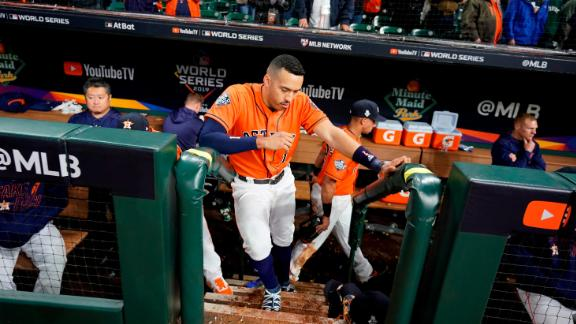 Houston shortstop Carlos Correa reacts in the dugout after the loss.
