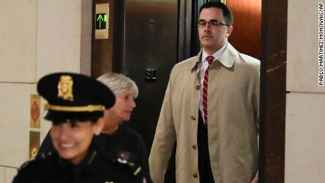 Former top national security adviser to President Donald Trump, Tim Morrison, right, arrives for a closed door meeting to testify as part of the House impeachment inquiry into President Donald Trump on Capitol Hill in Washington, Thursday, Oct. 31, 2019. (AP Photo/Pablo Martinez Monsivais)