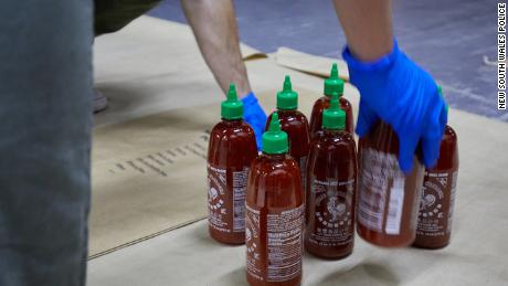 Australian police say they have found 400kg of methylamphetamine hidden in 768 bottles of Sriracha hot sauce.