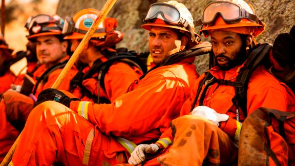 A crew of inmate firefighters takes a break from battling the Kincade Fire in Healdsburg, California.
