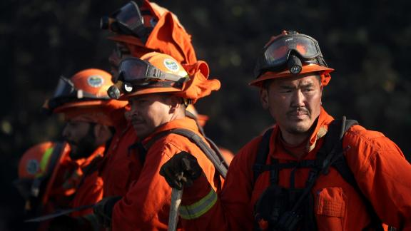 Inmate firefighters take a break while battling the Kincade Fire this week in Healdsburg, California.