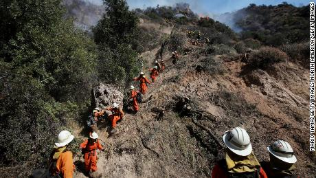 An inmate firefighter crew works in Los Angeles' Pacific Palisades neighborhood in October.