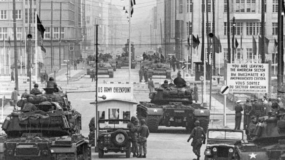 "Soviet and American tanks face off at the border crossing known as ""Checkpoint Charlie,"" in October 1961."