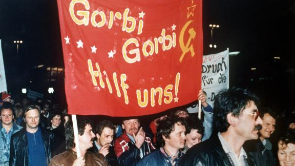 "Protesters carry a banner reading ""Gorbi Gorbi help us!"" during a visit to East Germany by Mikhail Gorbachev -- then leader of the Soviet Union -- in October 1989."
