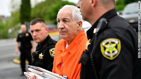 Jerry Sandusky enters the Centre County Courthouse for a hearing on May 2, 2016 in Bellefonte, Pa. The U.S. Department of Education is levying the largest fine in history against Pennsylvania State University for violations of federal crime reporting laws.
