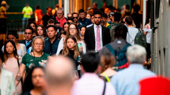 People commute to work at Wall Street in lower Manhattan on August 1, 2019 in New York City.