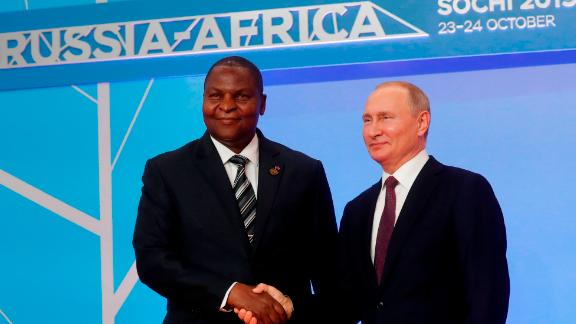 Russian President Vladimir Putin greets Central African President Faustin Archangel Touadera at the Africa Summit in Sochi.