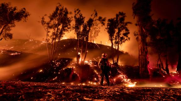 A firefighter works at containing the Maria Fire in the hills near Ventura, California, on November 1.